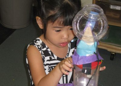Early Childhood Education - Girl learning Engineering through STEAM